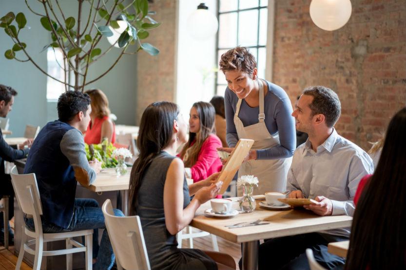 Restaurant scene server assisting table