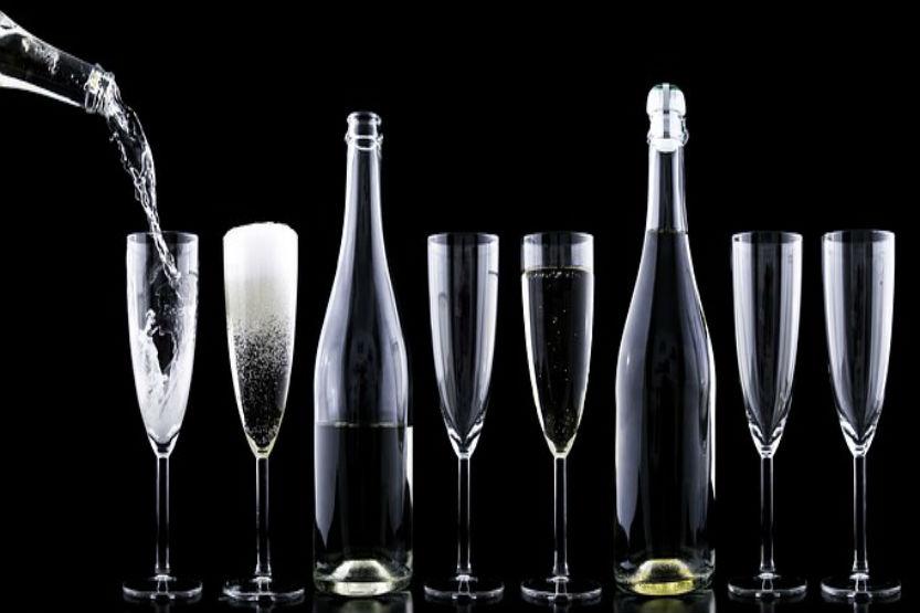 champagne flutes on bar top