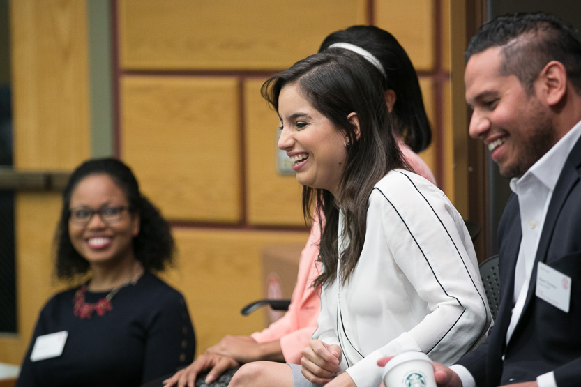 Photo of a student panel with a student laughing