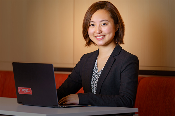 Sarah Song working at a laptop