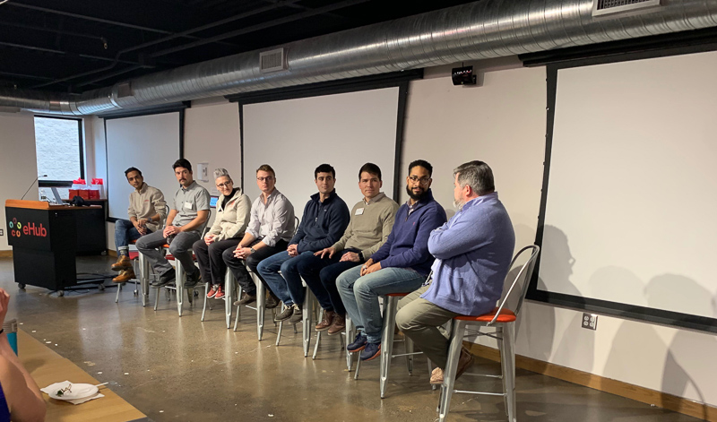 A panel discussion in the front of a room
