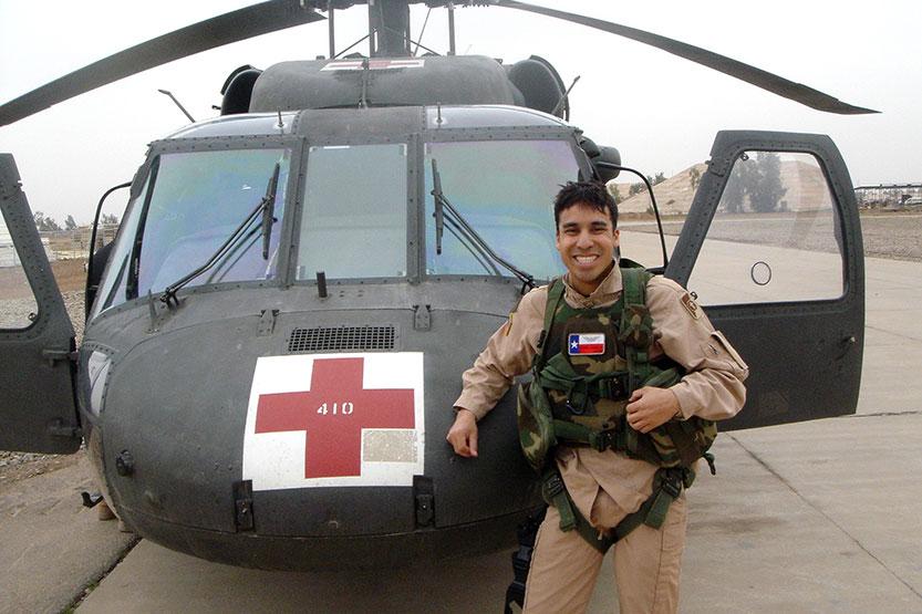 Anthony Garcia in front of Medevac hlicoptoer