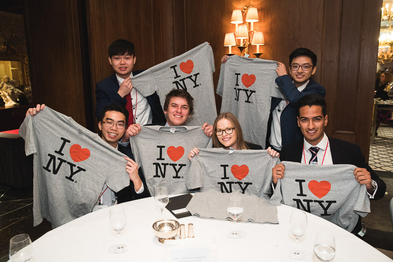 "Members of the University of Cambridge team holding ""I Love NY"" shirts"