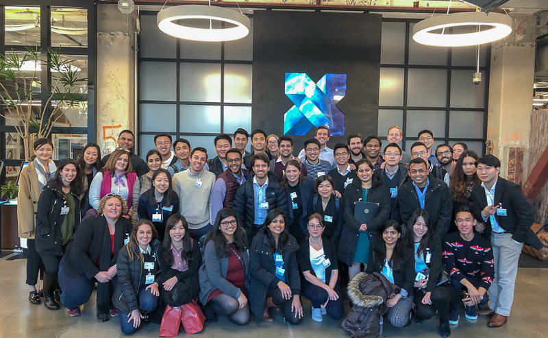 A large group of students in front of the Google X sign