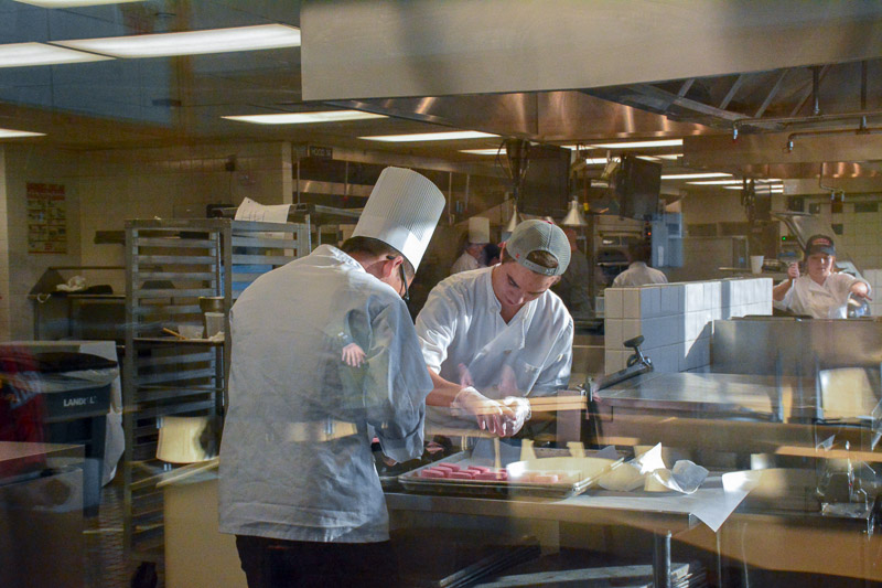 Student chefs working in the kitchen