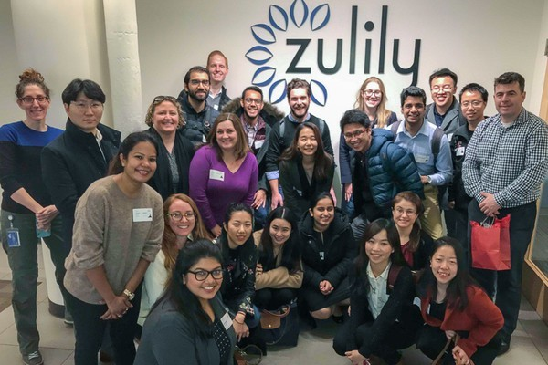 Students and visitors in front of a Zulily sign