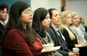 Audience listening to presentations
