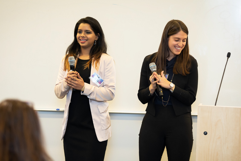 Chandi and Rebecca holding microphones