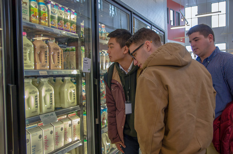 Students looking at coolers of milk