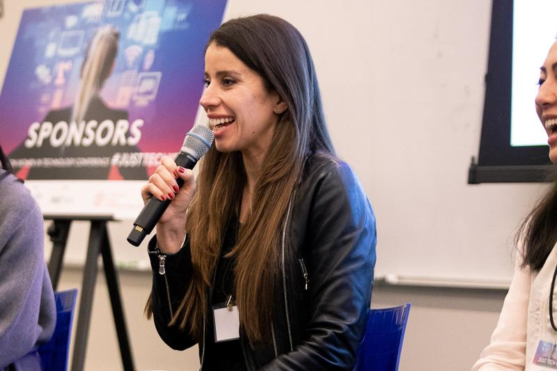 Vana holding a microphone