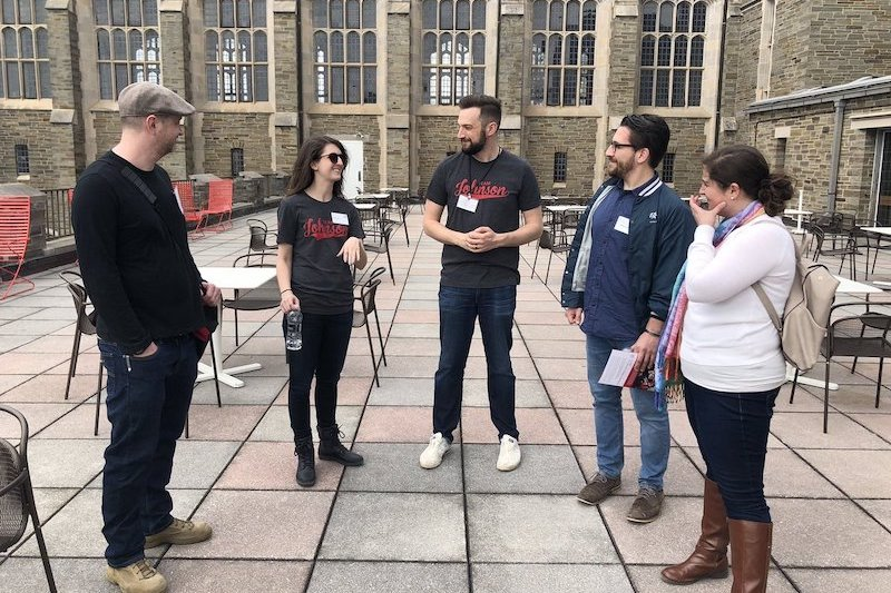 A group of students touring the Cornell campus