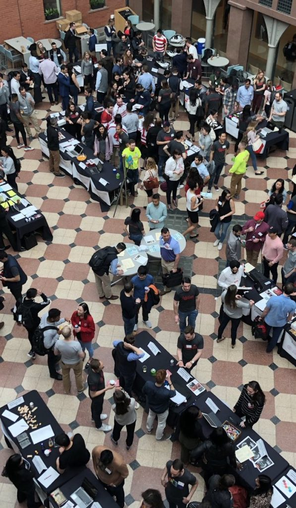 Overhead view of the Club Fair in a crowded Dyson Atrium
