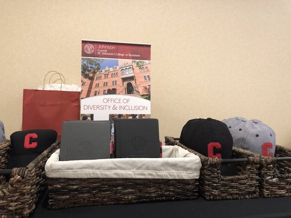 Table set up with baskets of Cornell swag from ODI