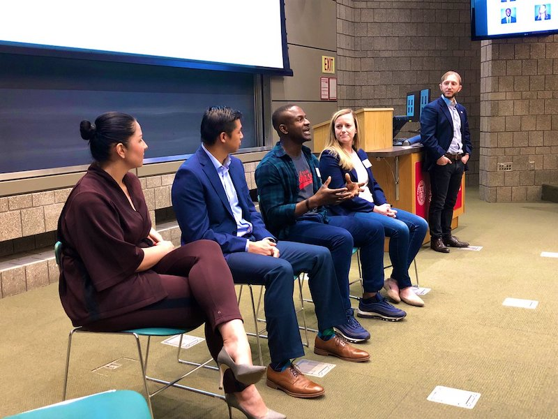 MBAs sit on a panel at the front of the room