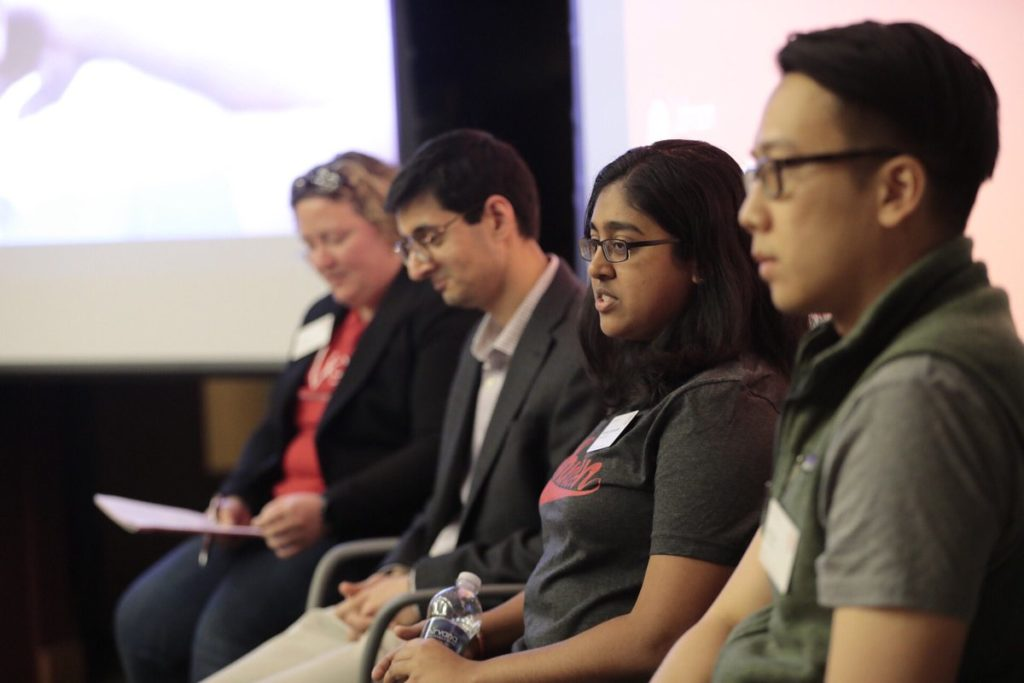 Students sit on a panel discussing Immersions