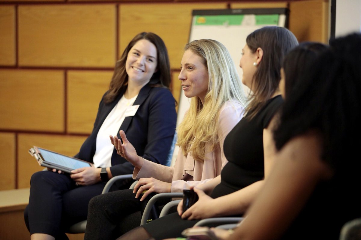 Genna Hartung speaking on a panel with other women MBAs