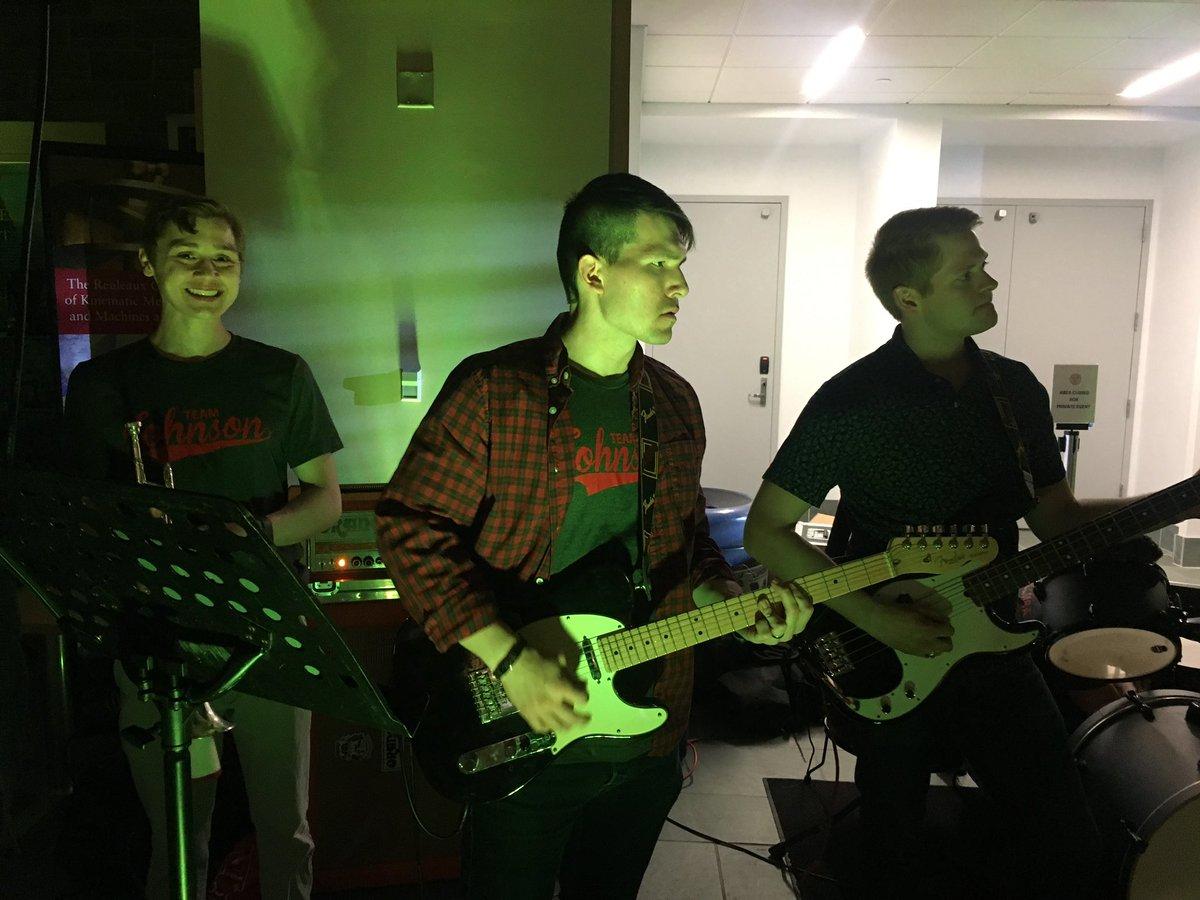 Three band members smiling