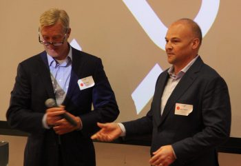 John Kyles and Alex Ivanov, MBAs '00 and founders of Big Red Ventures, speak at the first annual meeting nearly two decades after they left Johnson.