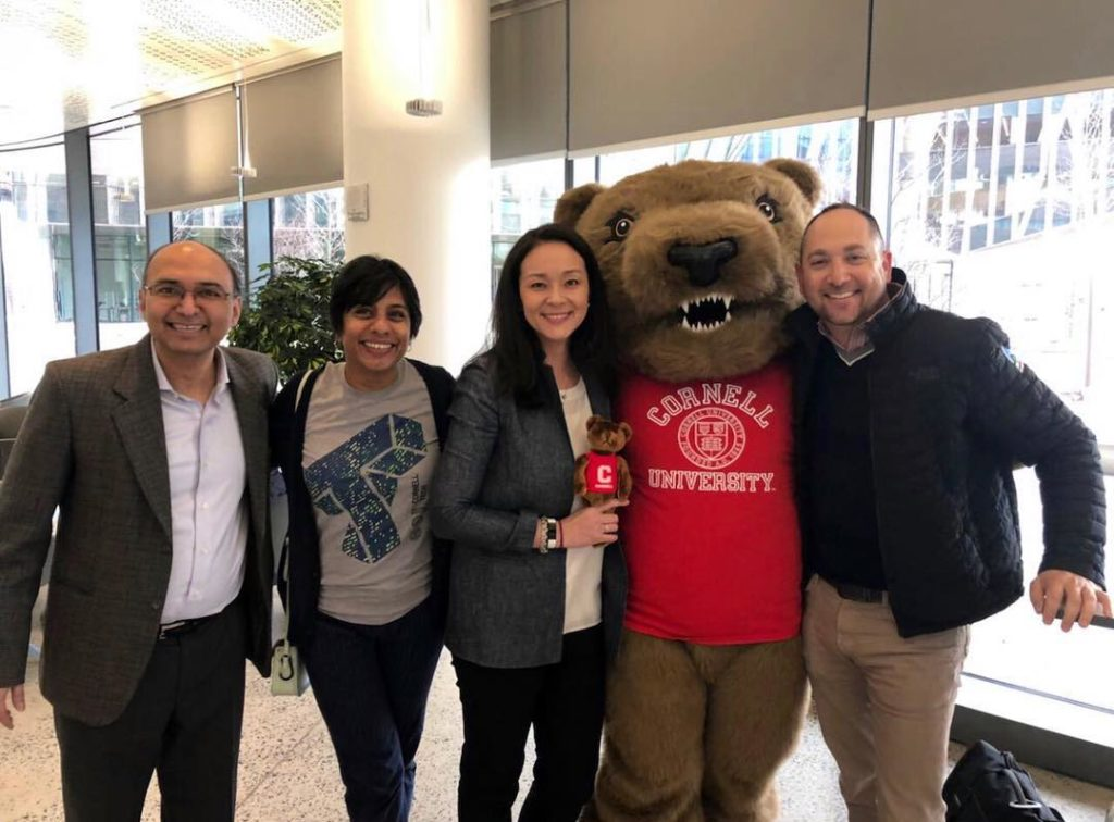 Admissions team and faculty poses with Touchdown the bear