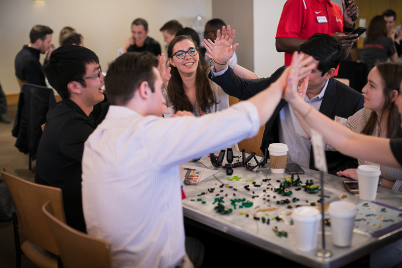 Lego team builders giving high fives