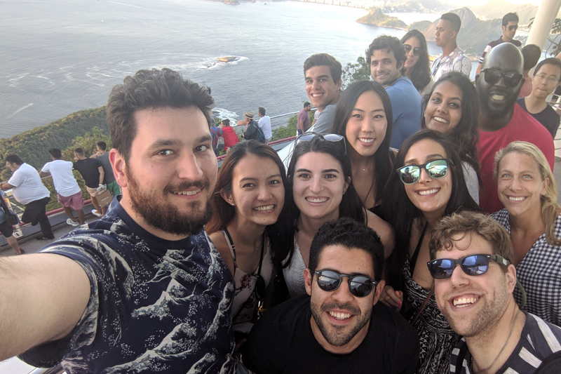 MBAs taking a selfie with Sugarloaf mountain in the background