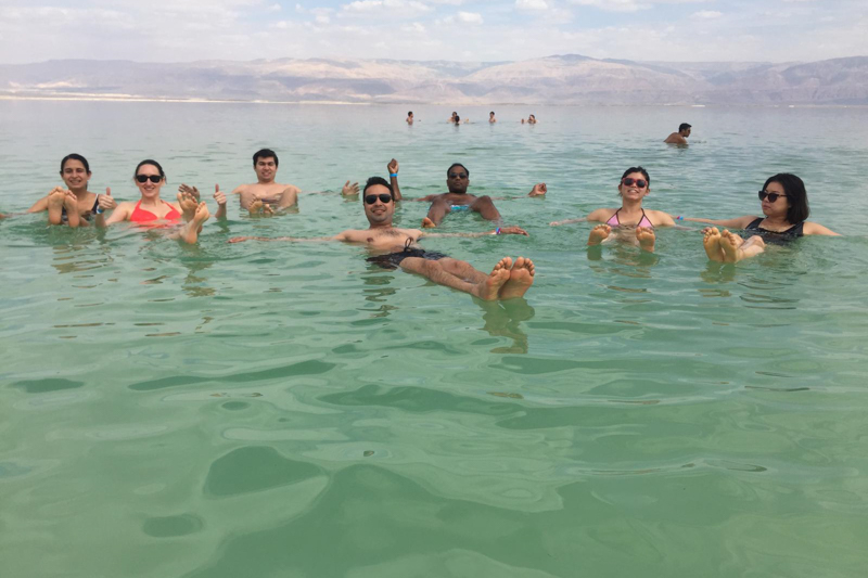 Students floating in the Dead Sea
