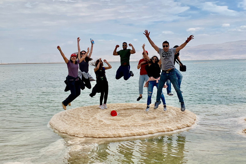 Jumping in the air over a small island in the Dead Sea