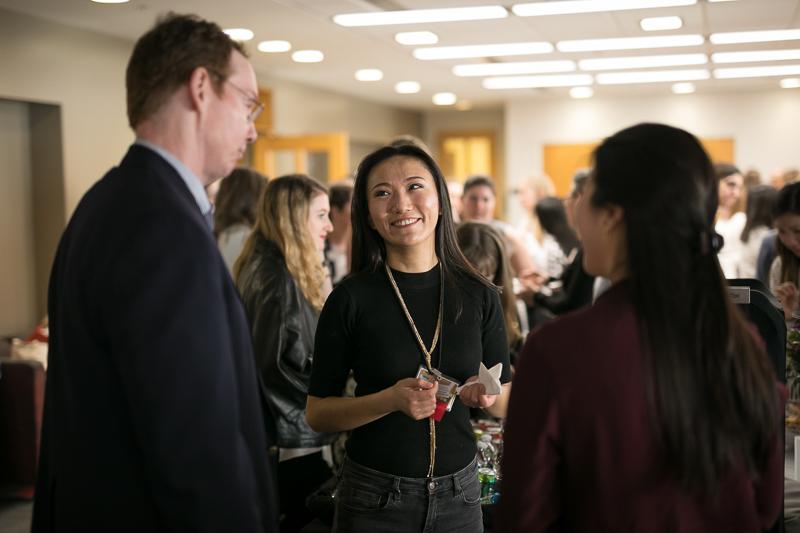 Students talking at the mixer