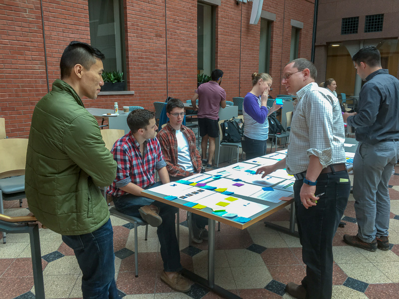 Mark Milstein talking with students
