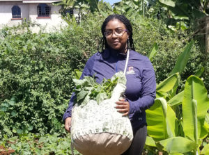 Ashley holding a bag of amaranth