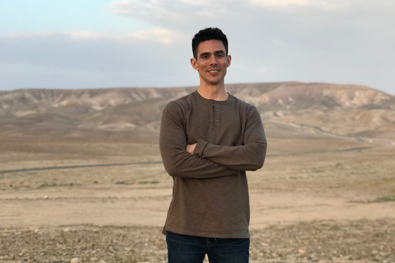 Mike Wagner with Bedouin Camp in the background