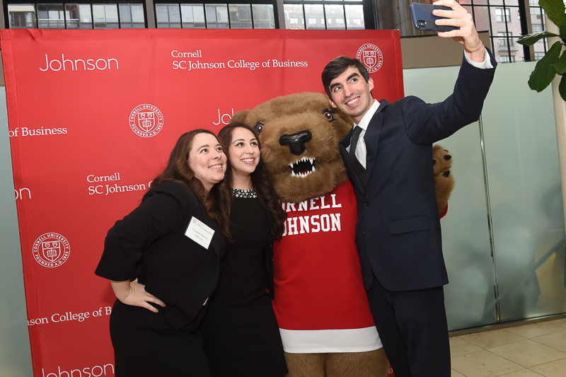 Guests take selfies with Touchdown the bear