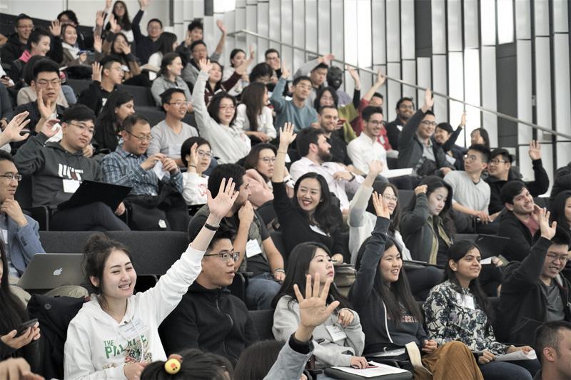 Audience raising their hands