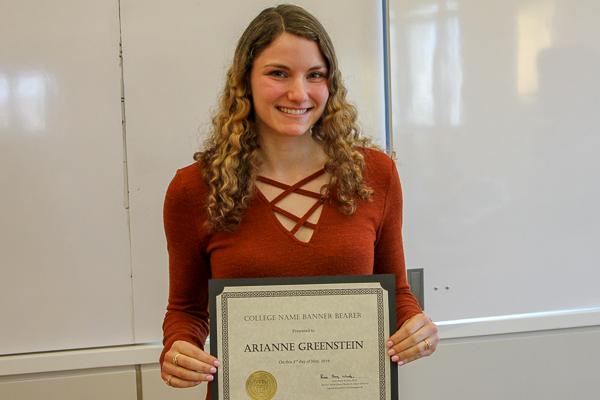 Adrianne Greenstein holding her award