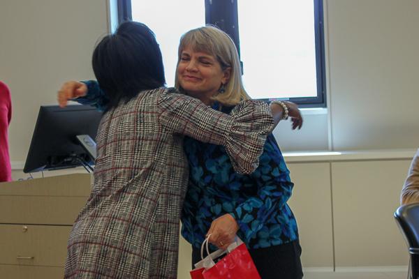Deb Streeter hugs Dean Wooten