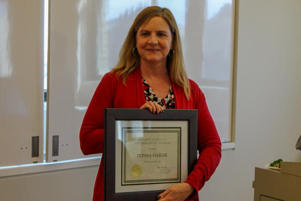 Donna Haeger holding her award