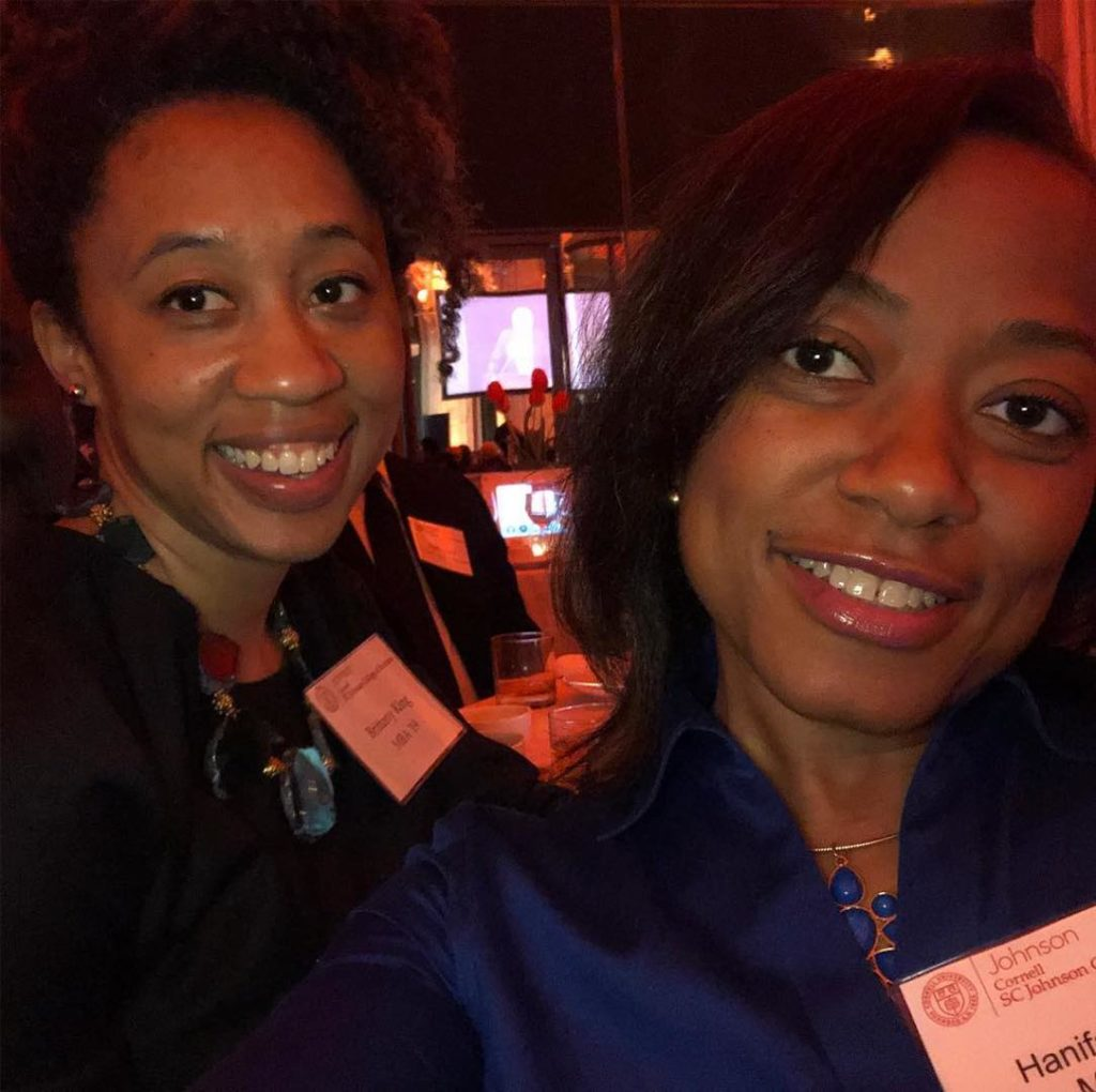 Two women at the Big Red Bash smiling and taking a selfie
