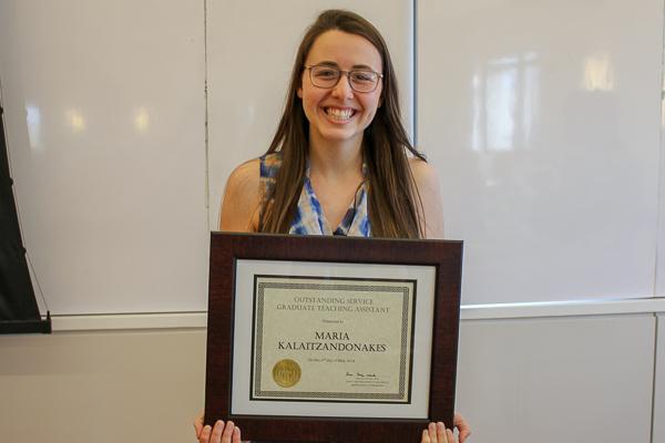 Maria Kalaitzandonakes holding her award