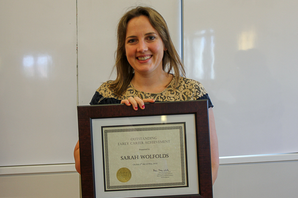 Sarah holding her award