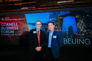 Kevin Hallock, dean of the Cornell SC Johnson College of Business, with guest speaker Gang Yu, MS '86, co-founder of grocery e-commerce platform Yihaodian and of healthcare platform 111 Inc.
