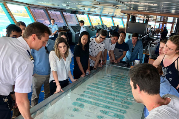 Students look at cruise ship plans