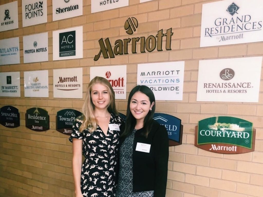 Two women standing in front of Marriott signs