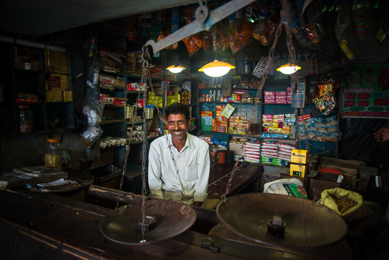 A Bandhan shopkeeper in his shop