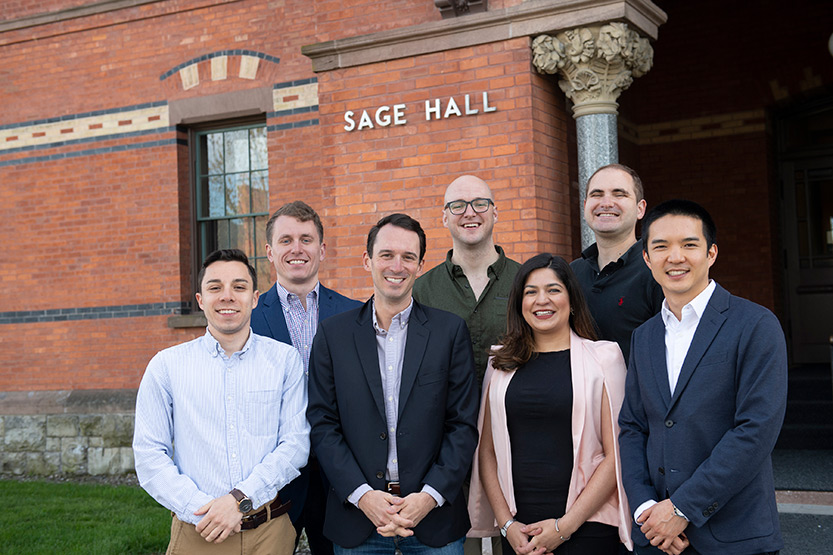photo of Present Value producers standing outside Sage Hall