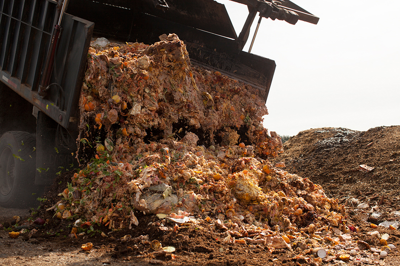 Garbage truck dumping enormous amounts of food waste