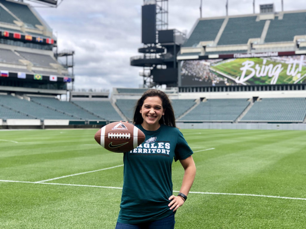 Sarah Baturka holding a football