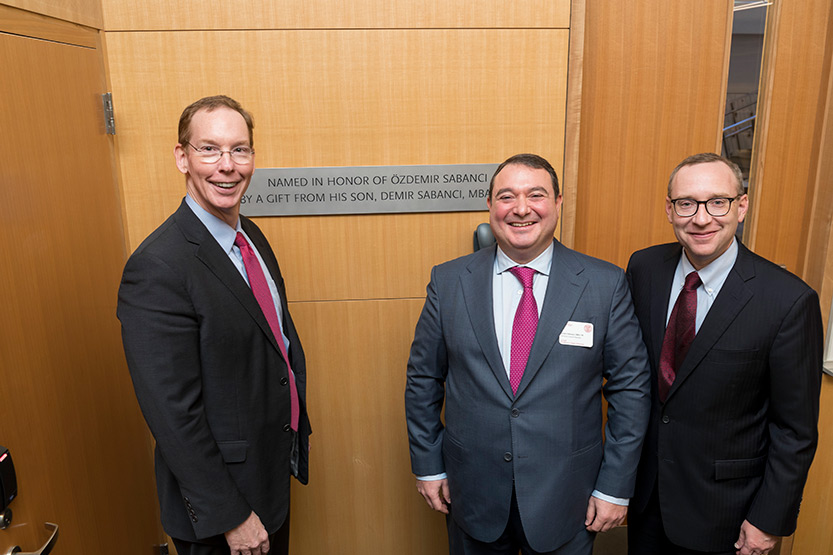 Dean Mark Nelson, Demir Sabanci, and Kevin Hallock, dean of the Cornell SC Johnson College of Business, in Breazzano LL23, next to the plaque honoring Demir's father, during the Sabanci Bridge dedication, Oct. 21, 2019