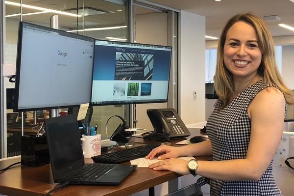 SHA alumna Cassandra Rampino '18 at her desk