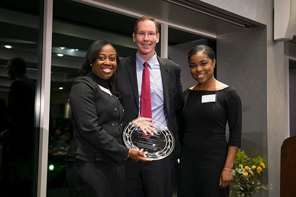 pictured left to right: Marmeline Petion-Midy, Dean Mark Nelson, and Sophia Marseille