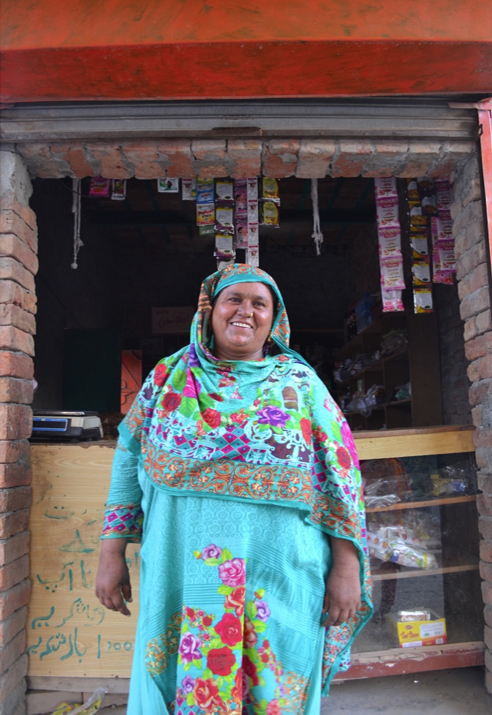 a community resource person stands in front of her store